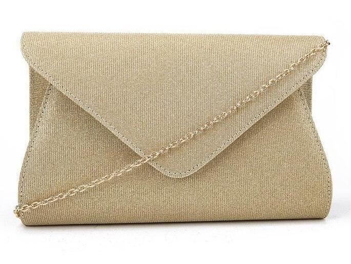 złota kopertówka z brokatem
